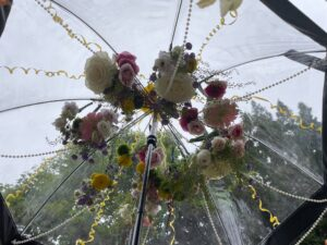 Umbrella decorated with fresh flowers