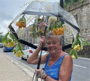 Lady with umbrella decorated with fresh flowers